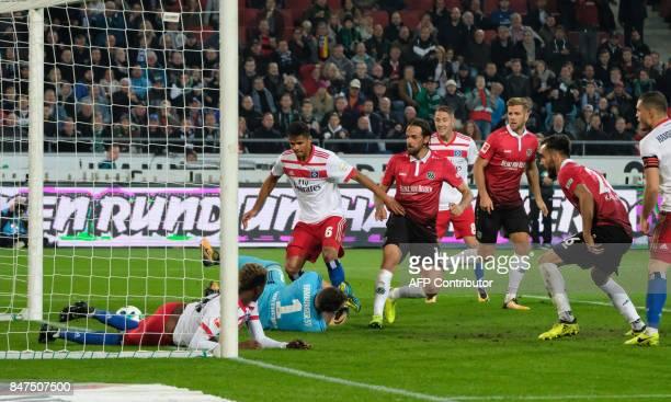 Hanover's Austrian forward Martin Harnik scores the opening goal during the German first division Bundesliga football match Hanover 96 vs Hamburg SV...