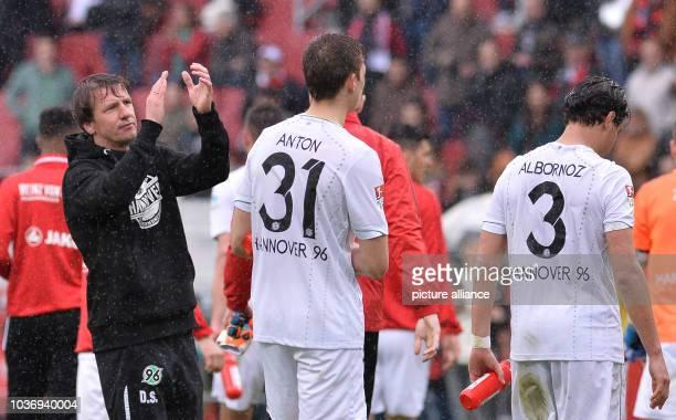 Hanover's coach Daniel Stendel applauding the fans after the German Bundesliga soccer match between FCIngolstadt and Hanover 96 at Audi Sportpark in...