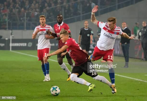 Hanover's German defender Matthias Ostrzolek and Hamburg's German forward Andre Hahn vie for the ball during the German first division Bundesliga...