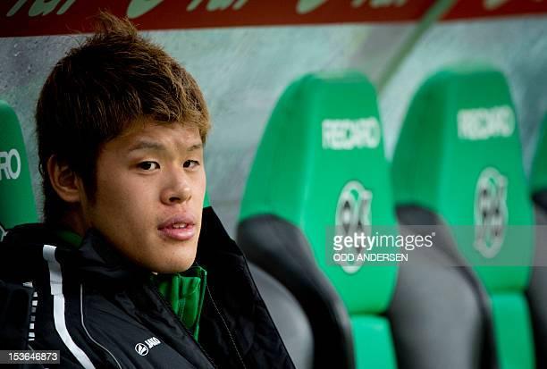 Hanover's Japanese defender Hiroki Sakai is seen on the bench prior to the German first division Bundesliga football match Hannover 96 vs Borussia...