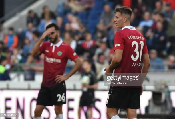 Hanover's Kenan Karaman and Waldemar Anton standing on the field after the German Bundesliga soccer match between Hannover 96 and Eintracht Frankfurt...