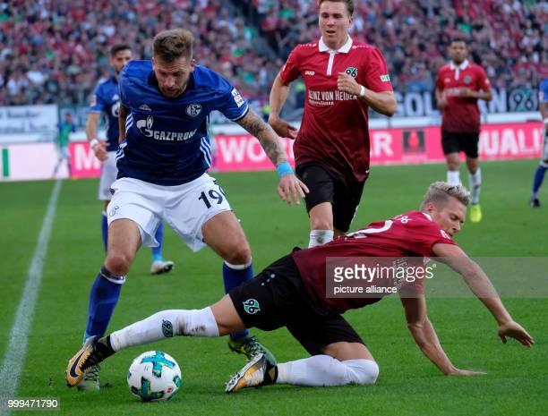 Hanover's Matthias Ostrzolek and Schalke's Guido Burgstaller in action during the German Bundesliga soccer match betweenHannover 96 and FC Schalke...