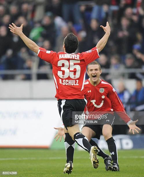 DFL Hanover's midfielder Bastian Schulz celebrates scoring during the German first division Bundesliga football match Hanover 96 vs Hamburg SV on...