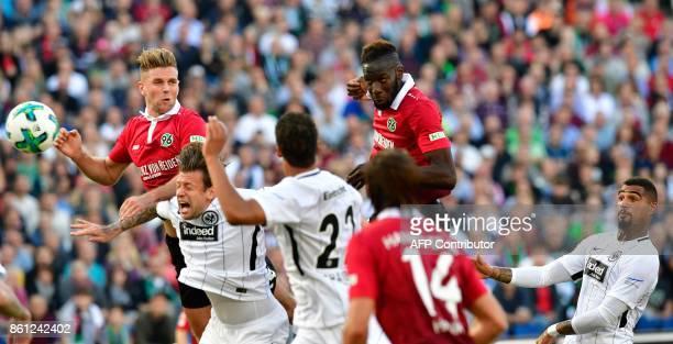 Hanover's Senegalese defender Salif Sane scores during the German First division Bundesliga football match TSG 1899 Hoffenheim vs FC Augsburg in...
