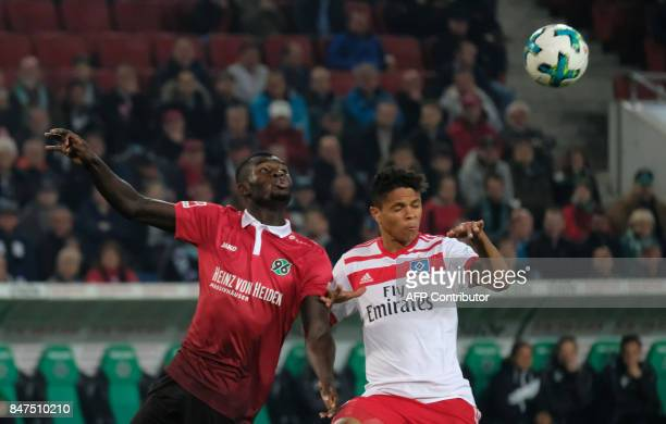Hanover's Togolese forward Ihlas Bebou and Hamburg's Brazilian defender Douglas dos Santos vie for the ball during the German first division...