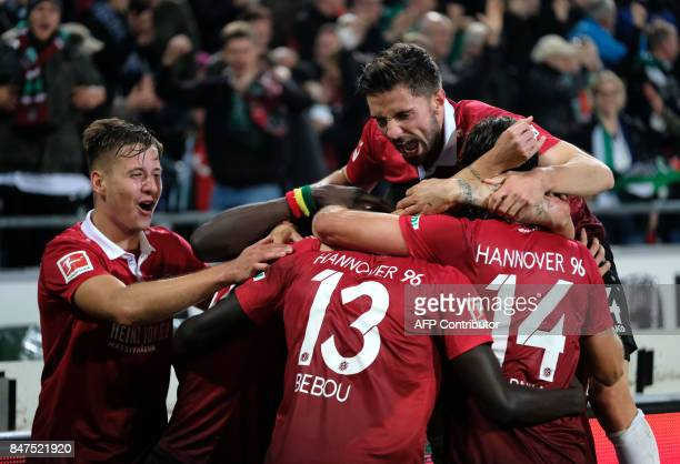 TOPSHOT Hanover's Togolese forward Ihlas Bebou celebrate scoring the 20 goal with his teammates during the German first division Bundesliga football...