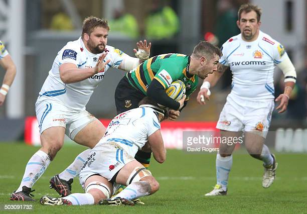 Hanrahan of Northampton is tackled during the Aviva Premiership match between Northampton Saints and Exeter Chiefs at Franklin's Gardens on January 1...