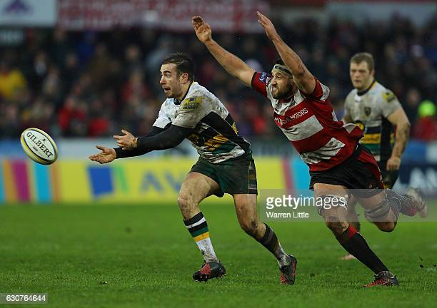 Hanrahan of Northampton Saints is tackled by Jeremy Thrush of Gloucester during the Aviva Premiership match between Gloucester Rugby and Northampton...
