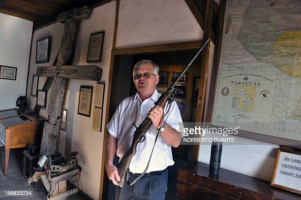 Hans Bochhmann responsible of the Mennonite museum shows a rifle used during Chaco's War in Filadelfia 500km north of Asuncion Paraguay on November 3...