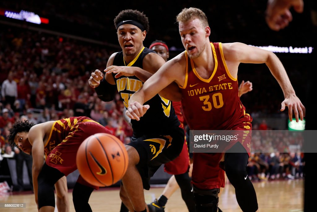 Hans Brase #30 of the Iowa State Cyclones battles for a rebound with Cordell Pemsl #35 of the Iowa Hawkeyes in the second half of play at Hilton Coliseum on December 7, 2017 in Ames, Iowa. The Iowa State Cyclones won 84-78 over the Iowa Hawkeyes.