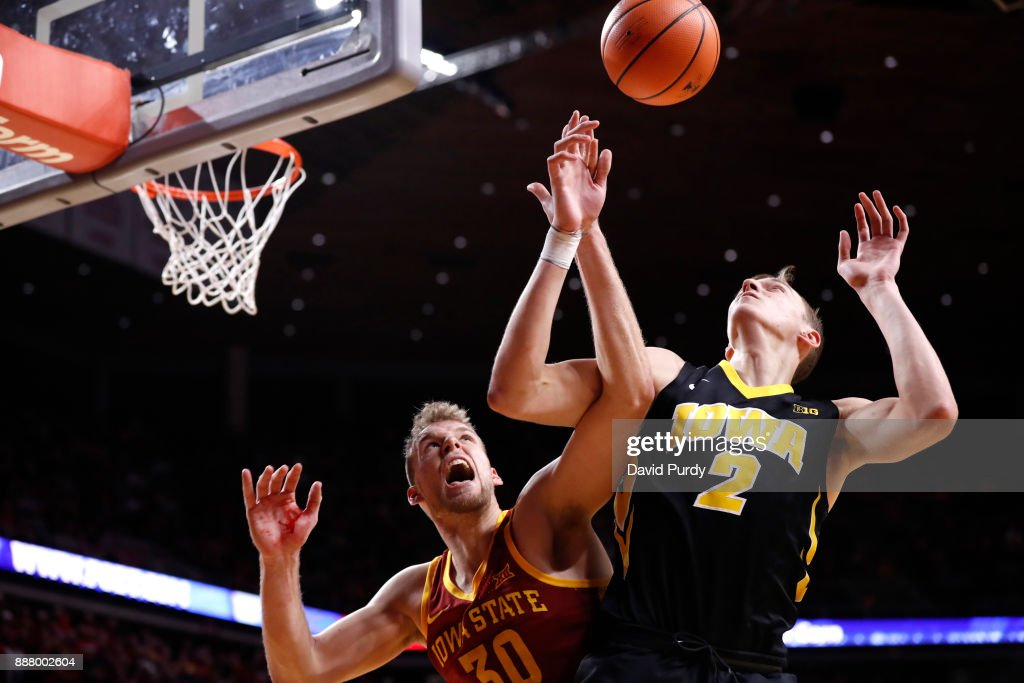 Hans Brase #30 of the Iowa State Cyclones blocks a shot by Jack Nunge #2 of the Iowa Hawkeyes in the second half of play at Hilton Coliseum on December 7, 2017 in Ames, Iowa. The Iowa State Cyclones won 84-78 over the Iowa Hawkeyes.