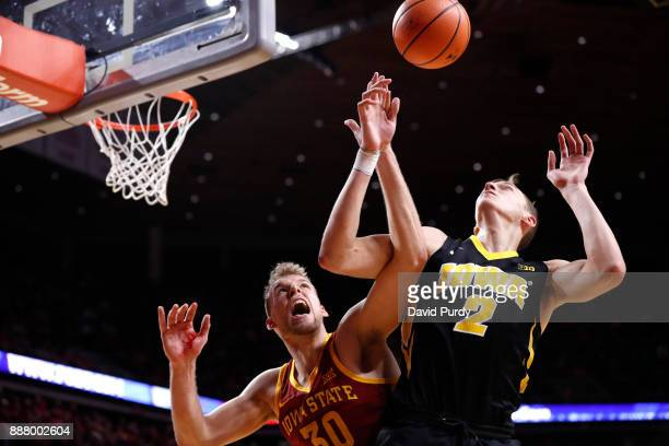Hans Brase of the Iowa State Cyclones blocks a shot by Jack Nunge of the Iowa Hawkeyes in the second half of play at Hilton Coliseum on December 7...