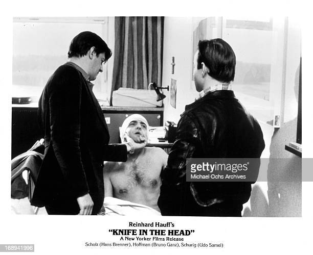 Hans Brenner visits Bruno Ganz with Udo Samel in a scene from the film 'Knife In The Head' 1978
