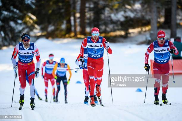 Hans Christer Holund of Norway Artem Maltsev of Russia and Andrey Melnichenko of Russia in action competes during the Men's 15 km C Pursuit at the...