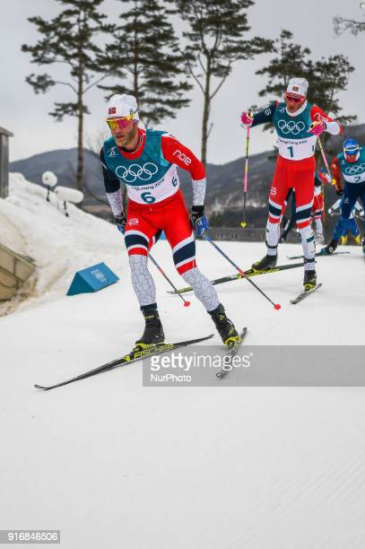 Hans Christer Holund ofNorway and Dario Cologna ofSwitzerland at Men's 15km 15km Skiathlon at olympics at Alpensia cross country stadium...