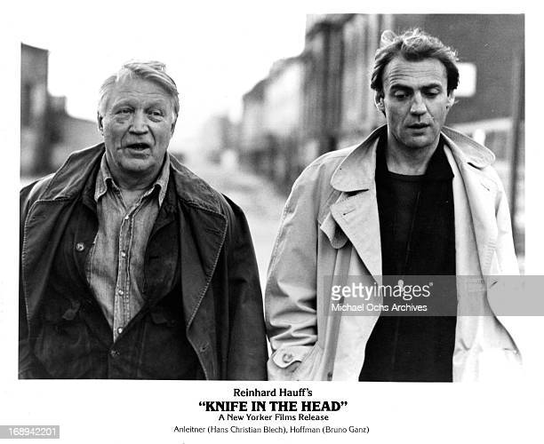 Hans Christian Blech walks with Bruno Ganz in a scene from the film 'Knife In The Head' 1978