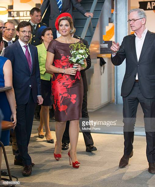 Hans de Jong Queen Maxima of The Netherlands and Hans Schroder attend the opening of the new Markthal on October 1 2014 in Rotterdam Netherlands The...