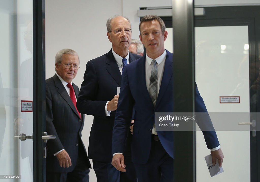 Hans Dieter Poetsch (C) and Wolfgang Porsche (L) , Chairman of the Supervisory Board of Porsche Automobil Holding, which has a major stake in Volkswagen, arrive to speak to the media after the Volkswagen supervisory board elected Poetsch as new chairman at Volkswagen headquarters on October 7, 2015 in Wolfsburg, Germany. Volkswagen, struggling to reassert itself following the diesel engines software scandal, is shuffling board members among new finctions. The software, which Volkswagen purposefully installed in order to manipulate diesel emissions results under testiung conditons, affects 11 million Volkswagen cars worldwide and the revelation by the U.S. Environmental Protections Agency (EPA) that it exists has plunged Volkswagen into its deepest crisis in its history.