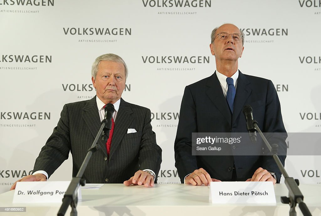 Hans Dieter Poetsch (C) and Wolfgang Porsche (L) , Chairman of the Supervisory Board of Porsche Automobil Holding, which has a major stake in Volkswagen, speak to the media after Volkswagen board members elected Poetsch as new chairman of the supervisory board of Volkswagen Group at Volkswagen headquarters on October 7, 2015 in Wolfsburg, Germany. Volkswagen, struggling to reassert itself following the diesel engines software scandal, is shuffling board members among new finctions. The software, which Volkswagen purposefully installed in order to manipulate diesel emissions results under testiung conditons, affects 11 million Volkswagen cars worldwide and the revelation by the U.S. Environmental Protections Agency (EPA) that it exists has plunged Volkswagen into its deepest crisis in its history.