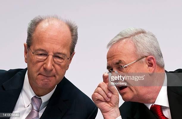 Hans Dieter Poetsch chief financial officer of Volkswagen AG left listens as Martin Winterkorn chief executive officer of Volkswagen AG speaks during...