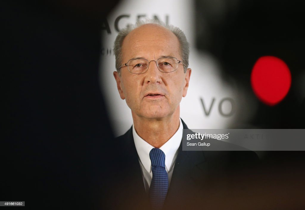 Hans Dieter Poetsch, seen between the equipment of a TV cameraman, speaks to the media after Volkswagen board members elected Poetsch as new chairman of the supervisory board of Volkswagen Group at Volkswagen headquarters on October 7, 2015 in Wolfsburg, Germany. Volkswagen, struggling to reassert itself following the diesel engines software scandal, is shuffling board members among new finctions. The software, which Volkswagen purposefully installed in order to manipulate diesel emissions results under testiung conditons, affects 11 million Volkswagen cars worldwide and the revelation by the U.S. Environmental Protections Agency (EPA) that it exists has plunged Volkswagen into its deepest crisis in its history.