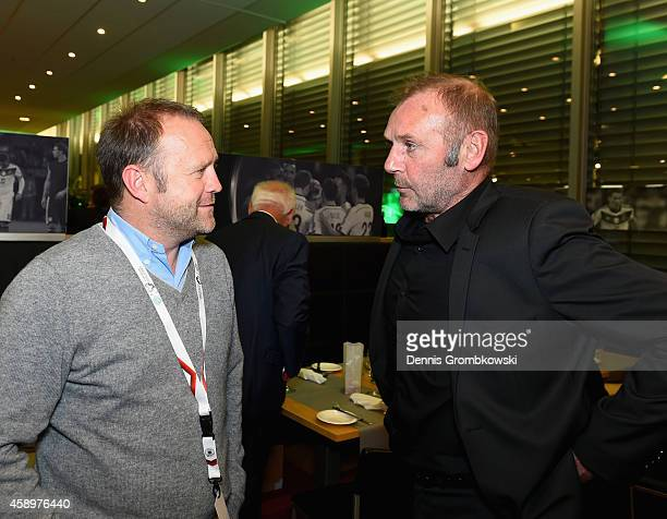 Hans Dorfner and Dieter Eckstein talk during the Club of former national players meeting at GrundigStadion on November 14 2014 in Nuremberg Germany
