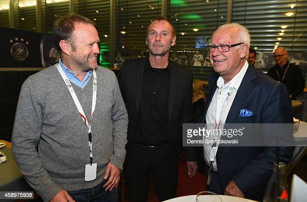 Hans Dorfner Dieter Eckstein and Manfred Ritschel pose during the Club of former national players meeting at GrundigStadion on November 14 2014 in...