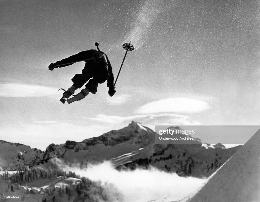 Hans Grage, an Olympic hopeful, appears to be jumping right over Mt. Rainier in this dramatic photo, Washington, January 5, 1935..