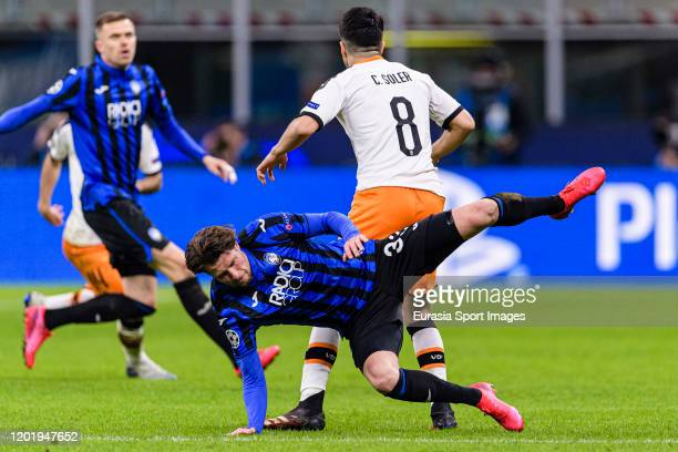 Hans Hateboer of Atalanta battles for the ball with Carlos Soler of Valencia CF during the UEFA Champions League round of 16 first leg match between...