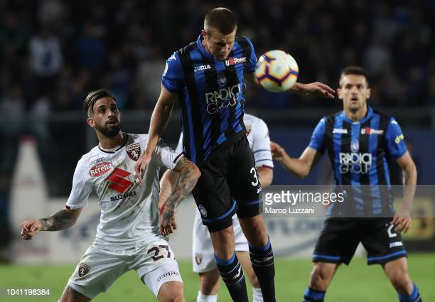 Hans Hateboer of Atalanta BC competes for the ball with Vittorio Parigini of Torino FC during the serie A match between Atalanta BC and Torino FC at...