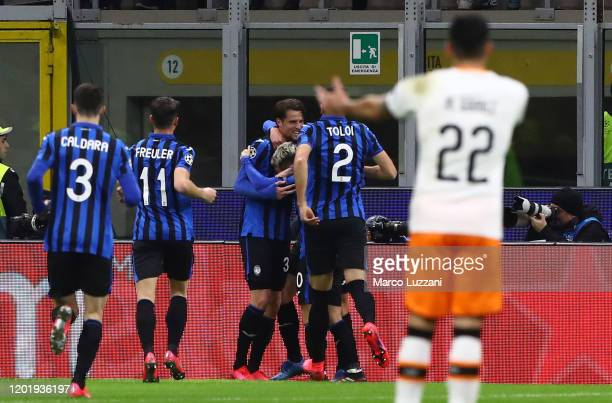 Hans Hateboer of Atalanta celebrates with his teammates after scoring the opening goal during the UEFA Champions League round of 16 first leg match...