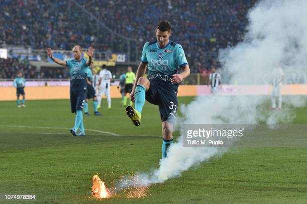 Hans Hateboer of Atalanta kicks a firework launched on the pitch during the Serie A match between Atalanta BC and Juventus at Stadio Atleti Azzurri...