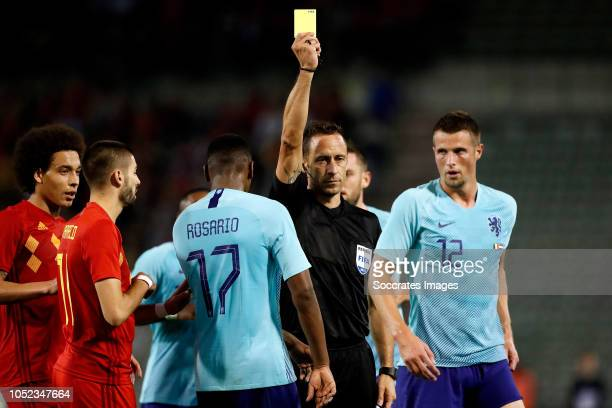 Hans Hateboer of Holland receives a yellow card from referee Arthur Soares Dias during the International Friendly match between Belgium v Holland on...