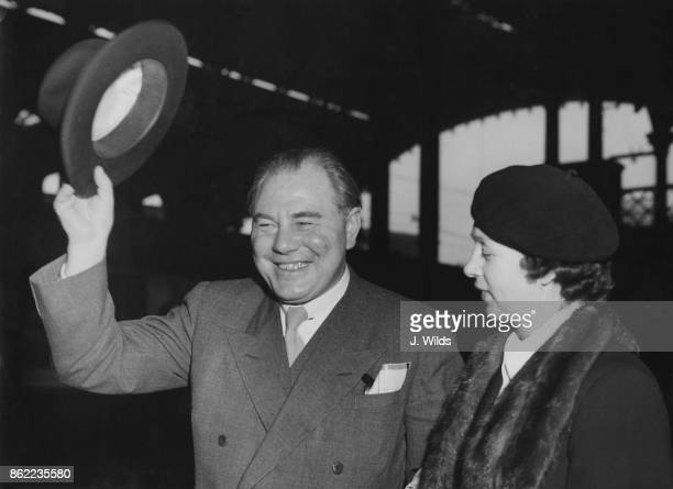 Hans Hedtoft , the Prime Minister of Denmark, arrives at Liverpool Street Station in London with his wife Ella, to attend the Anglo-Danish Society...