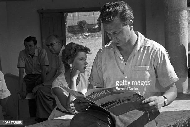Hans Herrmann Grand Prix of Italy Autodromo Nazionale Monza 05 September 1954 Hans Herrmann reading a copy of the French magazine Moteurs given by...
