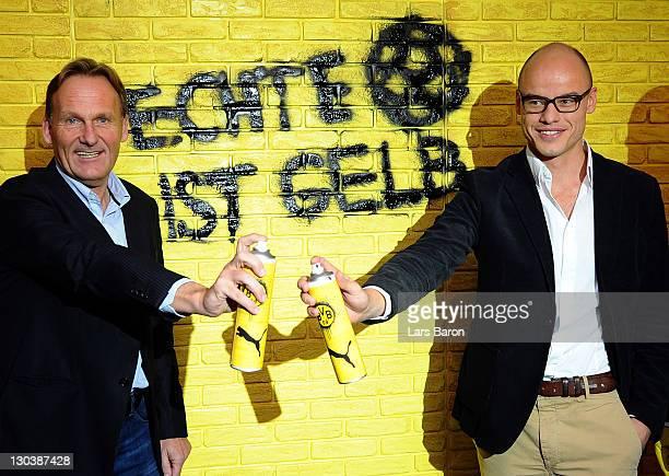 Hans Joachim Watzke, CEO of Borussia Dortmund, and Franz Koch, CEO of Puma, pose during a Borussia Dortmund and Puma press conference at Signal Iduna...