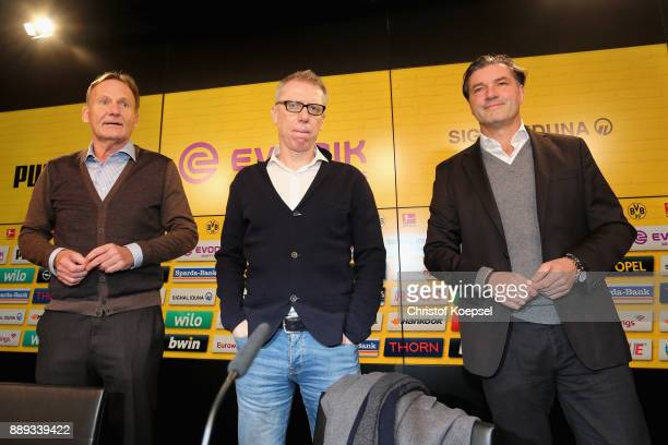 Hans Joachim Watzke chairman of the board and manager Michael Zorc prsrnt Peter Stoeger as the new head coach during the press conference at Signal...