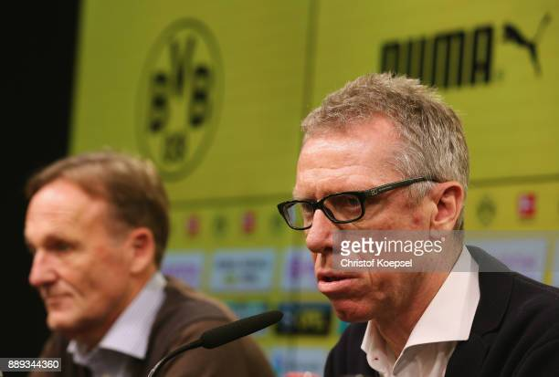 Hans Joachim Watzke chairman of the board and new head coahc Peter Stoeger of Dortmund during the press conference at Signal Iduna Park on December...