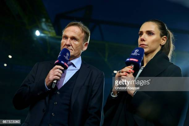 Hans Joachim Watzke chairman of the board of Dortmund and sky fild reporter Ester Sedlaczek look concerned after the match cancellation of the UEFA...