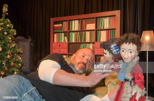 Hans Kautzmann drapes a marionette for a scene of the Augsburger Puppenkiste's new Christmas film in Augsburg Germany 05 May 2017 The Augsburger...