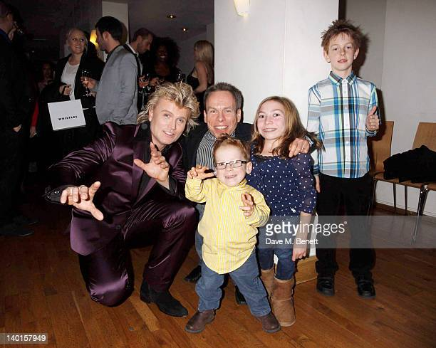 Hans Klok with actor Warwick Davis and family attend the press night performance of 'The Houdini Experience' at The Peacock Theatre on February 28...