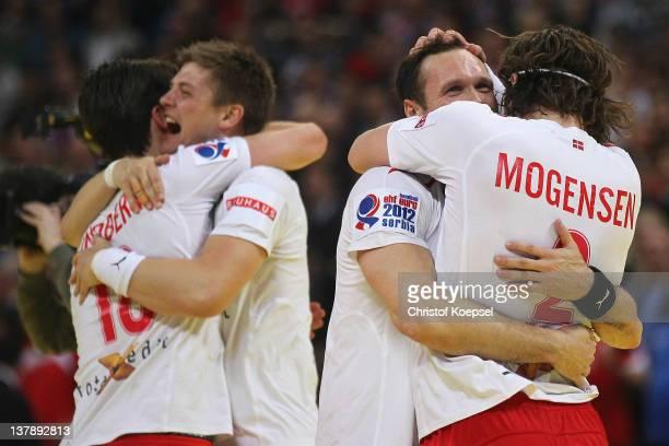 Hans Lindberg, Lasse Svan Hansen, Lars Christiansen and Thomas Mogensen of Denmark celebrates after winning 21-19 the Men's European Handball...