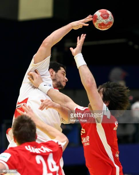 Hans Lindberg of Denmark blocks Carlos Peitro of Spain during the Men's Handball European qualifyer place 5 match between Denmark and Spain at the...