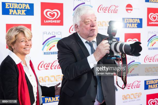 Hans Meiser takes pictures with a photographer's camera during the Radio Regenbogen Award 2017 at Europapark on April 7 2017 in Rust Germany