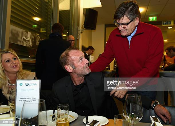 Hans Meyer greets Dieter Eckstein during the Club of former national players meeting at GrundigStadion on November 14 2014 in Nuremberg Germany