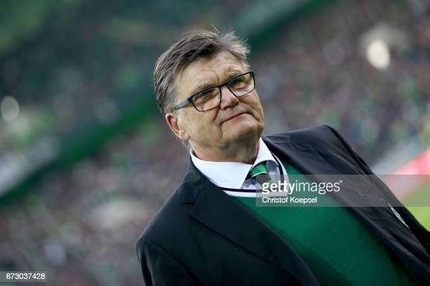 Hans Meyer, memeber of the presidium of Moenchengladbach looks on prior to the DFB Cup semi final match between Borussia Moenchengladbach and...