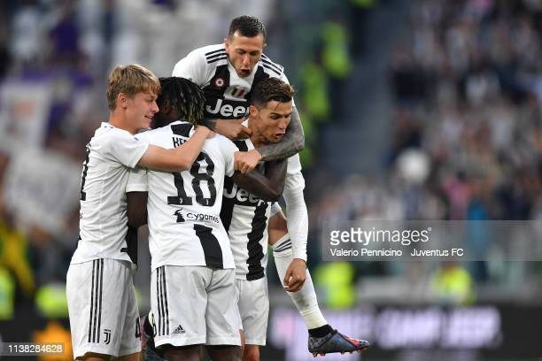 Hans Nicolussi Caviglia, Federico Bernardeschi, Moise Kean and Cristiano Ronaldo celebrate the winning of the Italian championship 2018-2019 after...