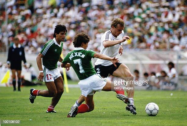 Hans Peter Briegal West Germany is challenged by Miguel Espana and Raul Servin of Mexico during the 1986 FIFA World Cup Quarter Final on 21 June 1986...