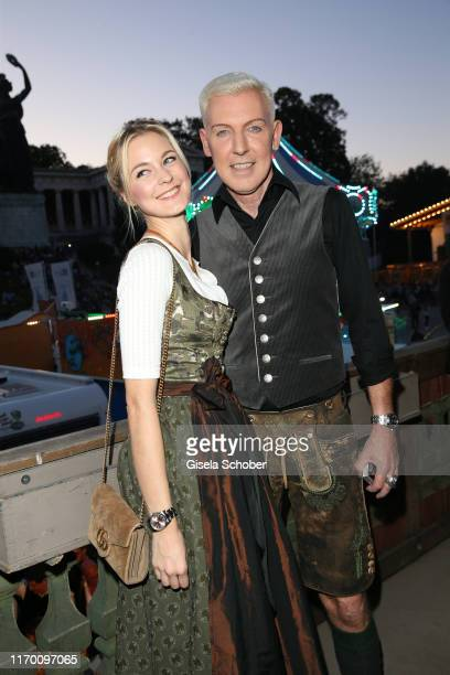 Hans Peter Geerdes HP Baxxter singer of Scooter and his girlfriend Lysann Geller during the Oktoberfest 2019 opening at Theresienwiese on September...