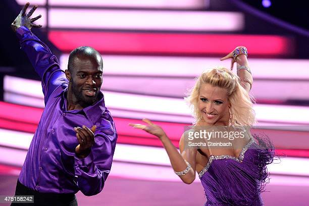 Hans Sarpei and Kathrin Menzinger perform on stage during the 11th show of the television competition 'Let's Dance' on May 29 2015 in Cologne Germany